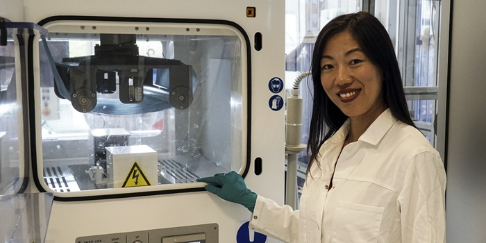 Wenjing (Angela) Zhang in front of the electrospinning equipment at DTU Energy
