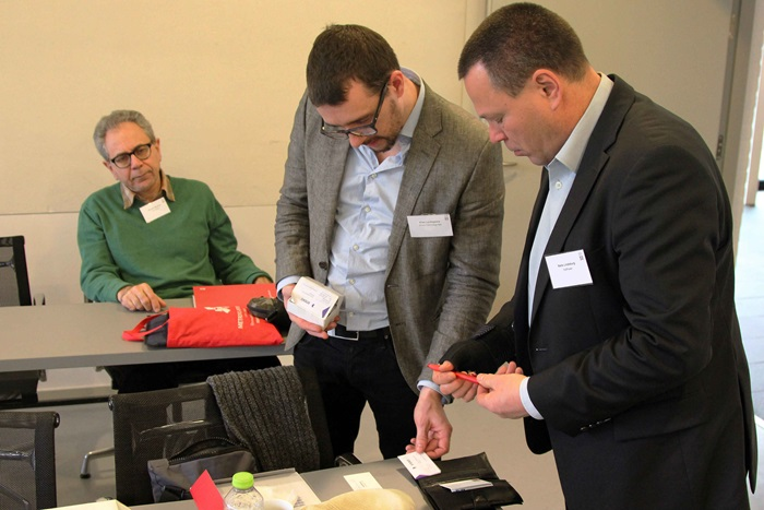 CEO of PeltPower Niels Lindeburg (right) exchange visit cards with a representative from Xnovo at DTU Energy's annual PhD symposium